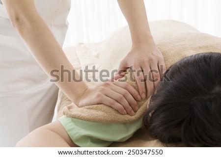 Upper arm massage - stock photo