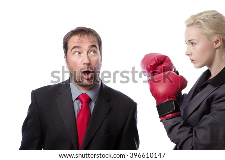 Upper body shot of two co-workers getting ready for a fight, one wearing boxing gloves.  isolated on white