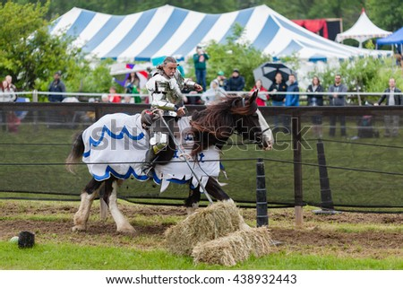 UPPER CANADA VILLAGE, MORRISBURG, ONTARIO, CANADA - JUNE 11, 2016: Jousting arena with knight on horseback at Medieval Festival.