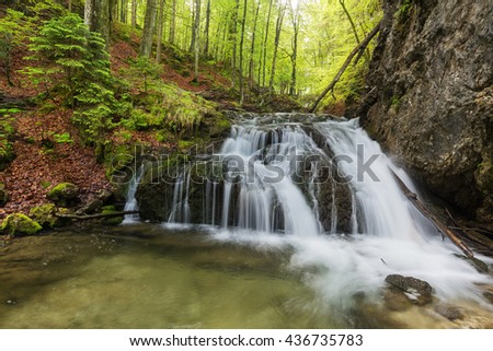 Upper cascade of Josefstal waterfall with fresh green foliage near lake Schliersee, Bavaria, Germany