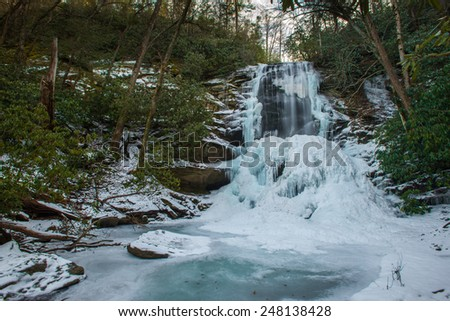 Upper Catawba Falls is frozen solid waiting for the Spring thaw. - stock photo