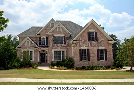 Upper class luxury home with intricate stonework and brick - stock photo