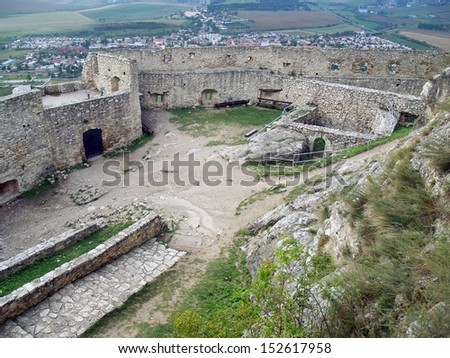 Upper courtyard with ruins of famous Spis castle (Spissky hrad). Spis castle is included in the UNESCO world heritage list and it is one of the biggest European castles by area (41 426 m2). - stock photo
