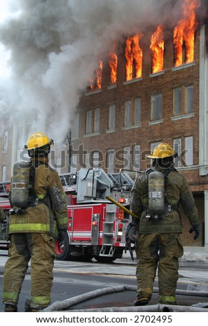 Upper floor of a Detroit apartment in flames - stock photo