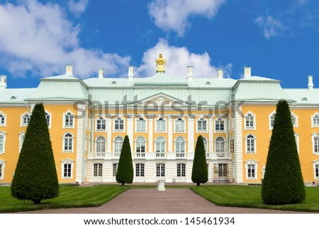 Upper garden facade of Peterhof Grand Palace against blue sky. Peterhof, Russia   - stock photo