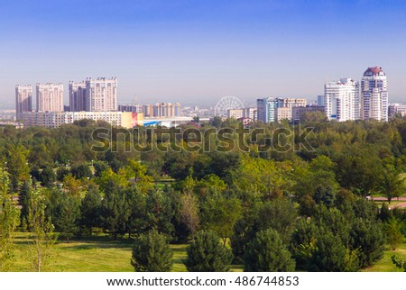 Upper part of the city of Almaty in the morning. Sunny September morning in a park.