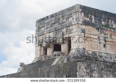 upper part of the temple of the jaguars viewed from the great ball court Chichen Itza Yucatan Mexico