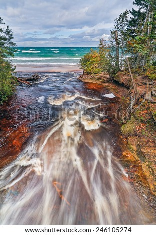 Upper Peninsula Michigan's Hurricane River flows into Lake Superior at Pictured Rocks National Lakeshore. - stock photo
