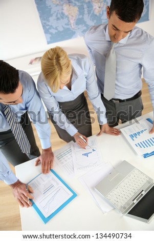 Upper view of business people working in office - stock photo