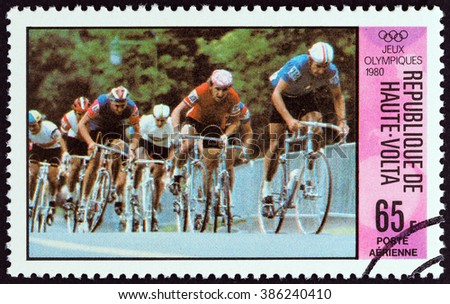 """UPPER VOLTA - CIRCA 1980: A stamp printed in Upper Volta from the """"Olympic Games, Moscow. Cycling """" issue shows Cyclists, circa 1980. - stock photo"""