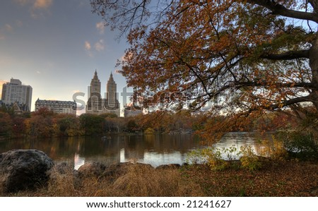 Upper West side of Manhattan as seen from Central Park in front of large boulder - stock photo