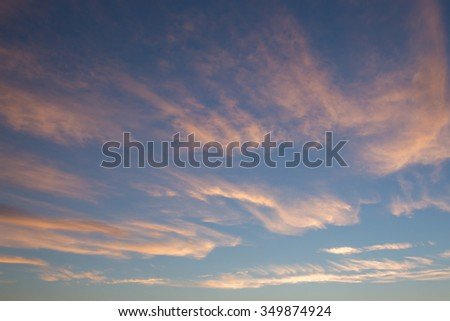 Upper Windblown Pink Cirrus Clouds at Sunset - stock photo