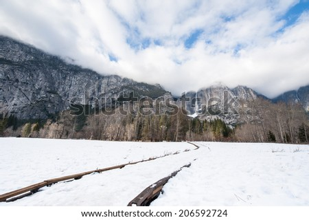 Upper Yosemite Falls and cloud cover - stock photo