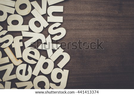 uppercase and lowercase wooden letters background on the table - stock photo