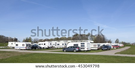 UPPSALA, SWEDEN ON MAY 06. View of caravans, campers and cars in Fyrishov camping on May 06, 2016 in Uppsala, Sweden. Road this side. Morning.