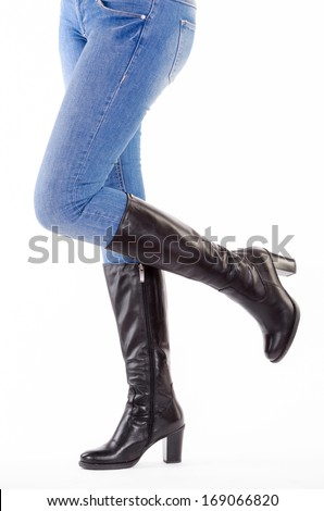 Upraised legs with jeans isolated - stock photo