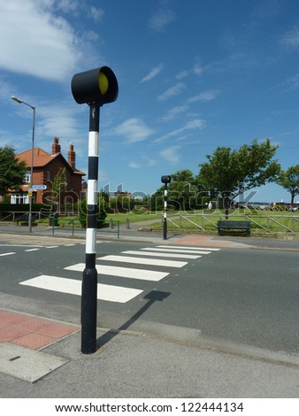 Upright view of urban zebra crossing without traffic. - stock photo
