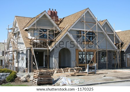 Upscale executive home, under construction - stock photo