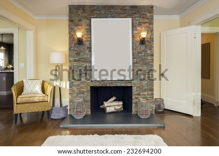 Upscale Fire Place in living room with rug, chair and wooden floor.  - stock photo