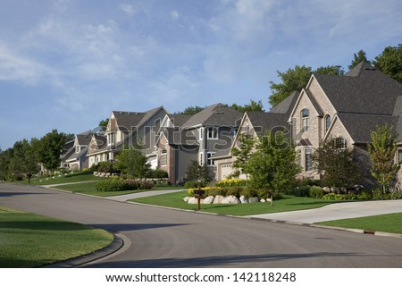 Upscale houses on a suburban street in the USA - stock photo