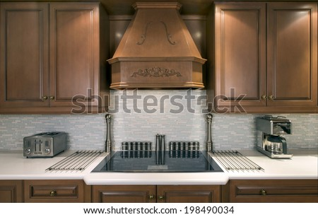 Upscale kitchen with electric cook-top  - stock photo