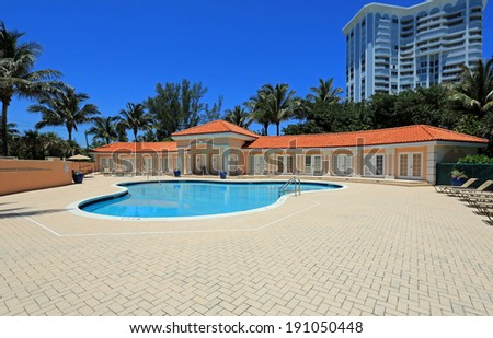 Upscale swimming pool and cabanas on Singer Island, in South Florida, USA - stock photo