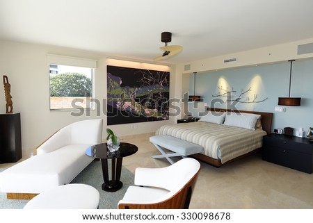 Upscale, uncluttered master bedroom suite in a luxury condominium.