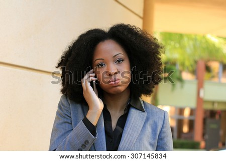 Upset and Frustrated Professional African American Business Woman College Student With Black Hair - stock photo