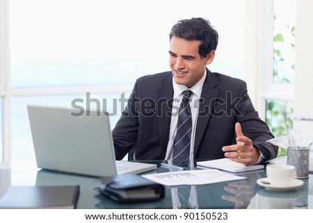 Upset businessman during a video conference in his office - stock photo