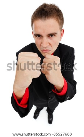 Upset businessman showing his fists, ready to fight - stock photo