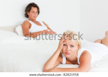 Upset couple after having an argument on their bedroom