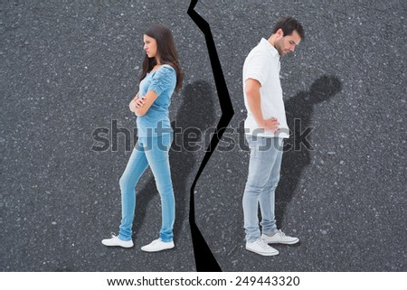 Upset couple not talking to each other after fight against road - stock photo