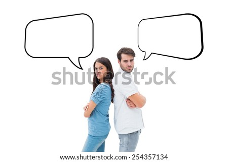 Upset couple not talking to each other after fight against speech bubble - stock photo