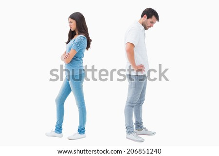 Upset couple not talking to each other after fight on white background