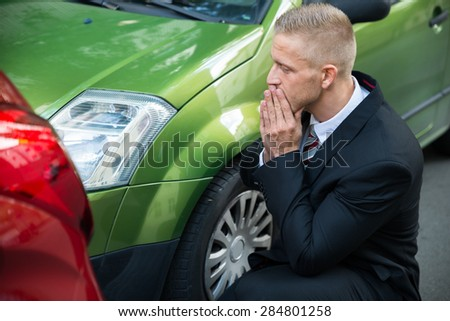 Upset Driver In Front Of Automobile Crash Car Collision - stock photo