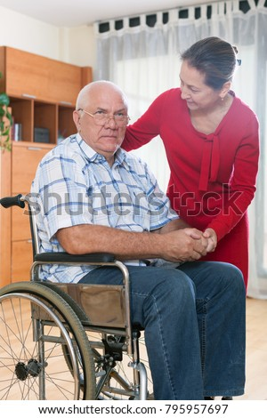 upset elderly couple of   woman and   man  in   wheelchair