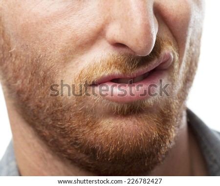 upset ginger young man mouth closeup