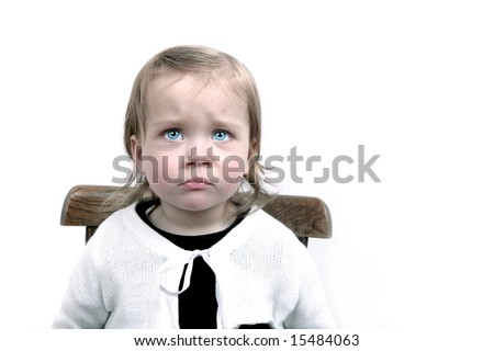 Upset little baby girl wearing cute white cardigan - stock photo
