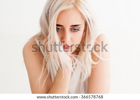 Upset lonely woman looking down in disappointment. The concept of divorce, misunderstanding, loneliness. photo on the white background - stock photo