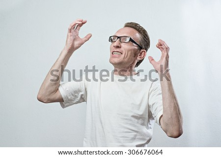 Upset man in anger look left and up his hands - stock photo