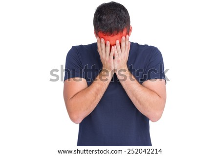 Upset man standing with his head between hands in white background - stock photo