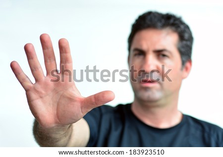 Upset mature man show stop sign with his palm. Copy space on white background.real people.Concept photo of dislike, displeasure,disagreement, disapprove, refusal, refuse, rejection, stop, no, negative - stock photo