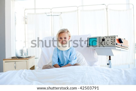 Upset patient with a neck brace sitting on a hospital bed. Medical concept.