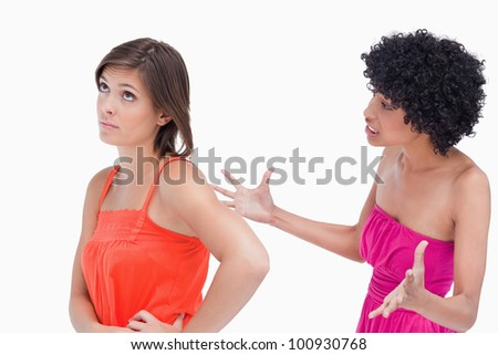Upset teenager shouting against a white background - stock photo