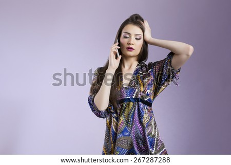 Upset woman receiving worrying news by the phone - stock photo