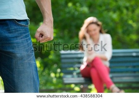 Upset Woman Sitting On Bench After Having Argument At Park