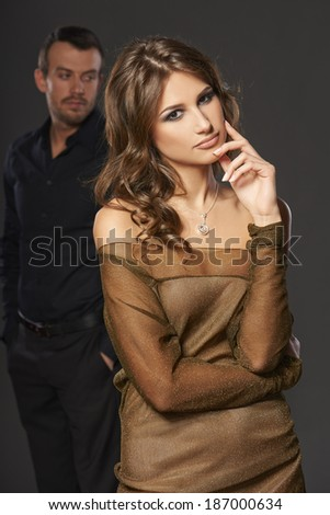 Upset young couple having marital problems or a disagreement looking in different directions ignoring one another. - stock photo