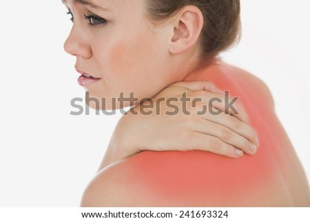 Upset young woman suffering from backache against white background
