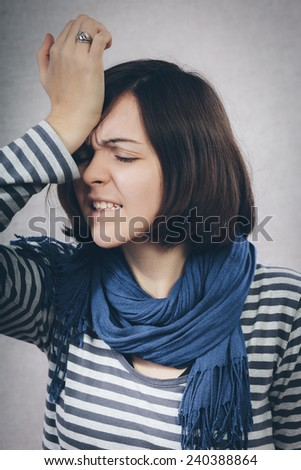 upset young woman with hand on his head - stock photo