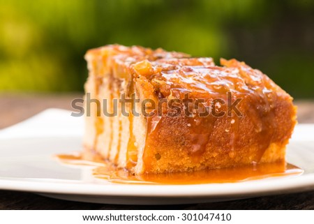 Upside down banana cake with coconut and caramel - stock photo